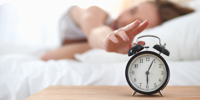 Moving your alarm clock out of reach means you'll have to get out of bed to turn it off, therefore making you get up.